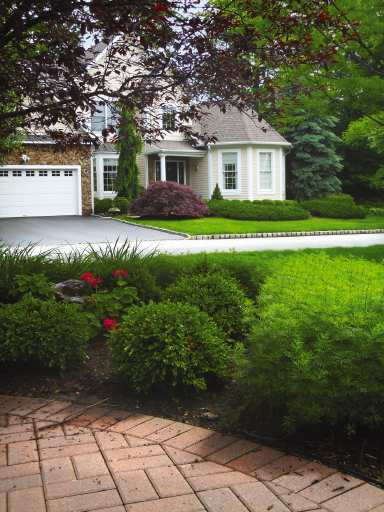 Front yard driveway joy studio design gallery best design for Curb appeal landscaping