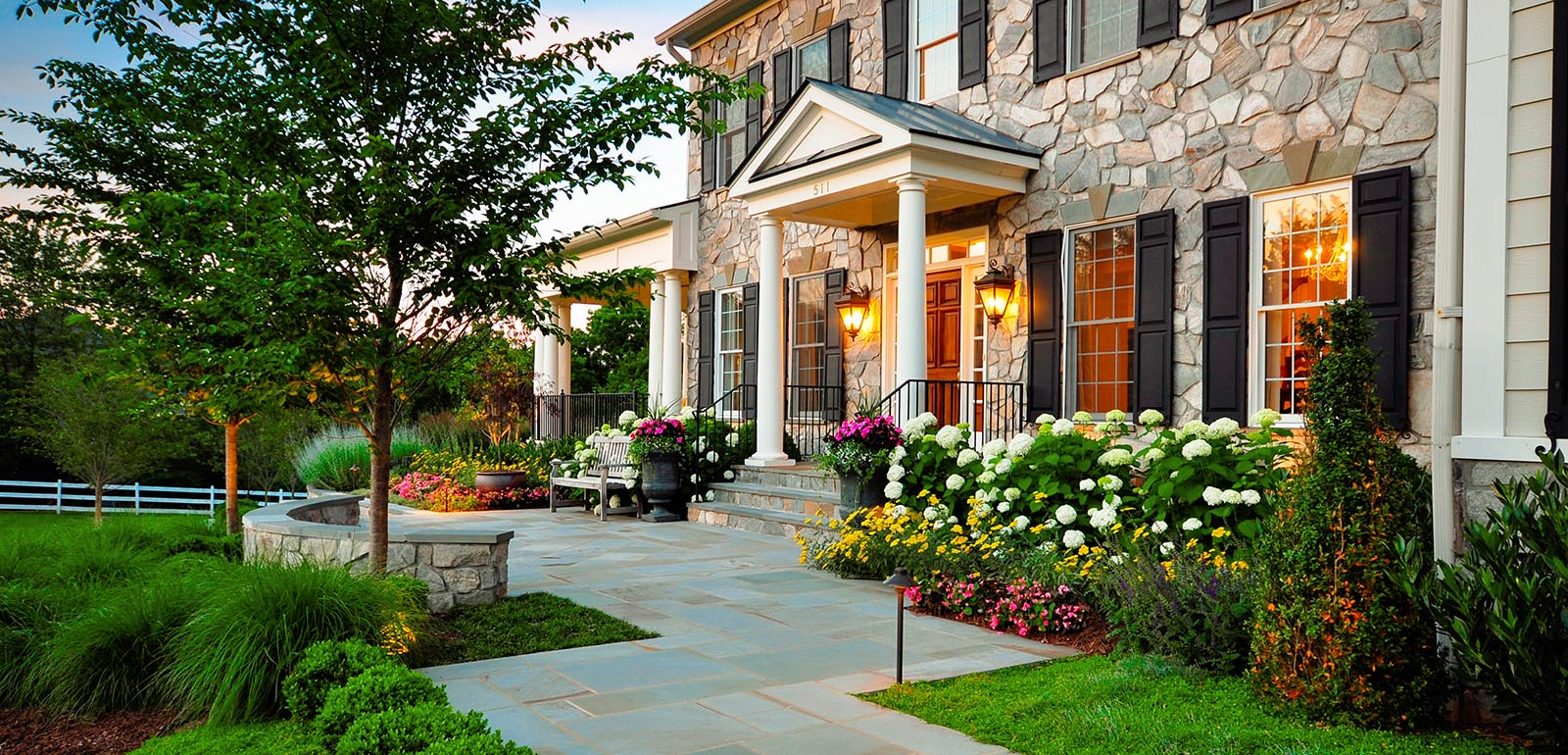 Beautiful house exterior and yard decorating with flowers and plants - Plant And Grow Trees